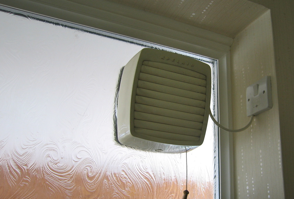 An ugly, inadequate extractor fan in a UK home