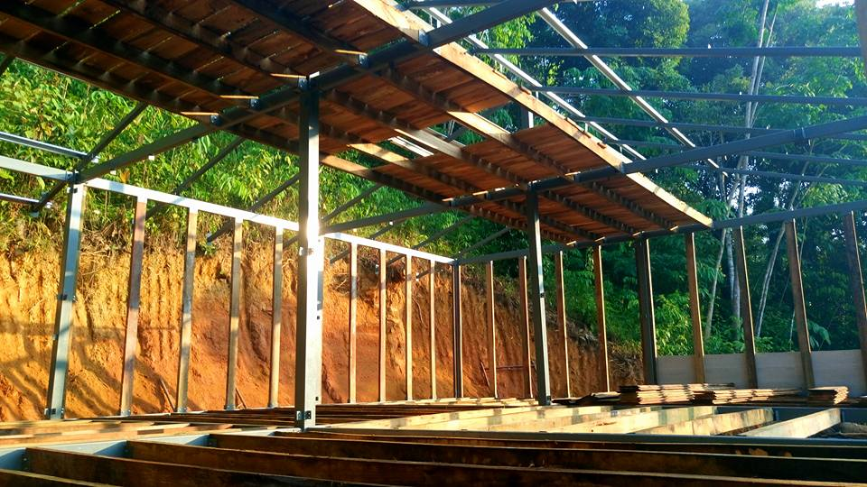 Malaysian jungle cabin with wall and floor joists and attic storage