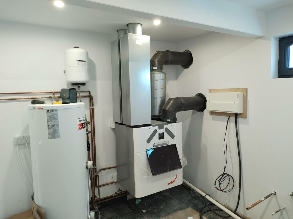 Installed Zehnder Q350 MVHR HVAC with pre-heater in a plant room