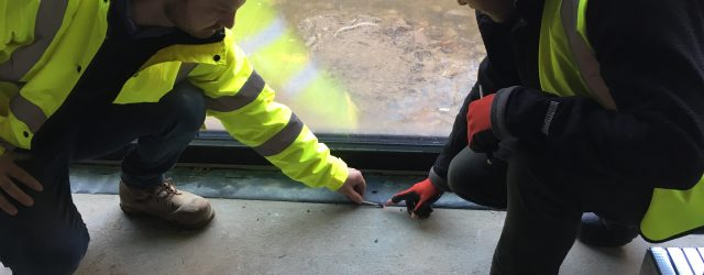 Using a smoke pen to detect leaks during airtightness testing