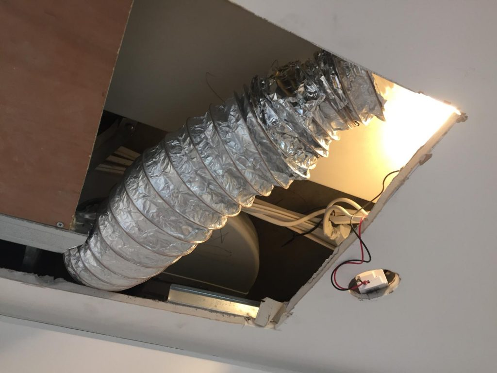 Badly fitted flexi-duct used to make ducting fit - poorly taped MVHR