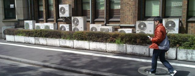 Air conditioning units scatter the exterior of a building